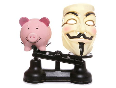 guy fawkes mask: Guy fawkes mask with piggy bank on a white background Editorial