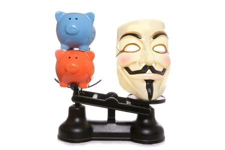 guy fawkes mask: Guy fawkes mask with two piggy banks on a white background Editorial