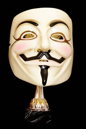 guy fawkes mask: Guy fawkes mask with trophy on black background Editorial