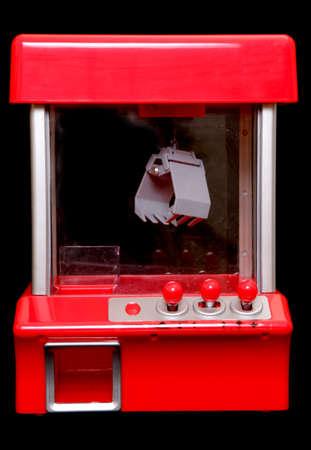 grabber: gambling grabbing machine on black background