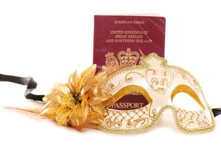 Masquerade mask and British passport on a white background photo
