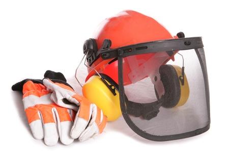 protectors: Orange workers helmet gloves and ear protectors studio cutout