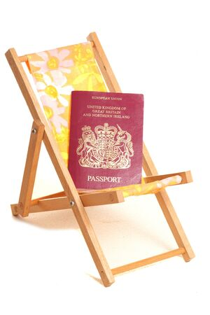 moon chair: summer holiday with passport cutout Stock Photo