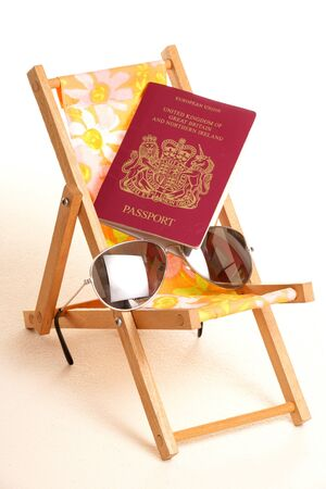moon chair: summer holiday with sunglasses and passport cutout Stock Photo