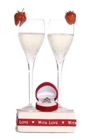 engagement ring: champagne with engagement ring studio cutout Stock Photo