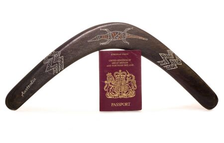 Boomerang and british passport studio cutout Stock Photo - 15313055