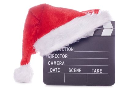 christmas movies: Christmas hat with film board cutout Stock Photo