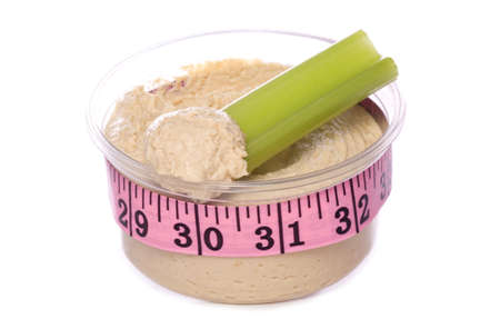 Celery and hummus with tape measure studio cutout Stock Photo - 17474840