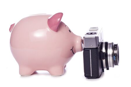 piggybank with an old camera studio cutout photo