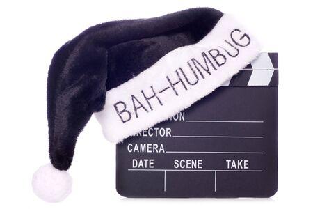 humbug: Bah humbug santas hat on movie clapper board cutout Stock Photo