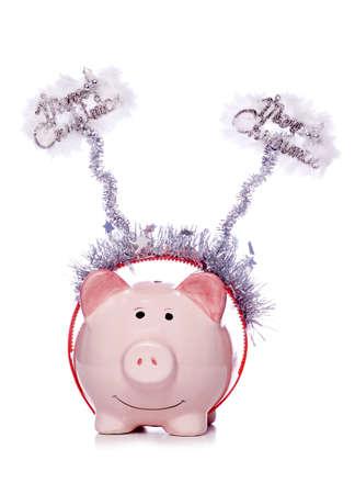 Piggy bank wearing christmas fancy dress studio cutout photo