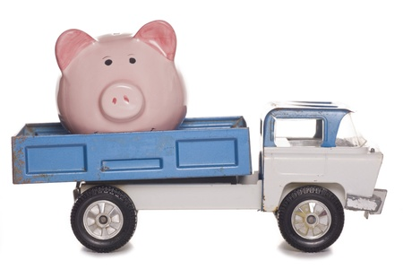 dodgy: piggy bank in the back of a lorry studio cutout