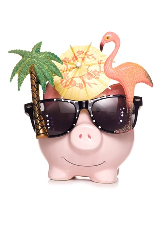 business savings: piggy bank with holiday sun glasses studio cutout