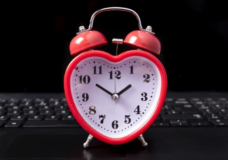 finding love: heart clock on a laptop