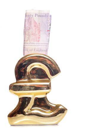 Pound symbol money box with twenty pounds cutout photo