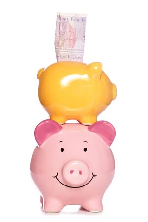Piggy banks stacked studio cutout photo