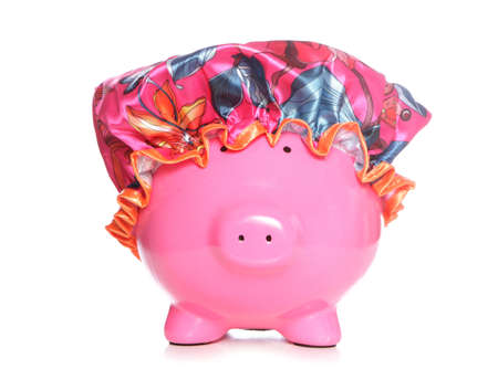 save water: piggy bank wearing shower hat on white background Stock Photo