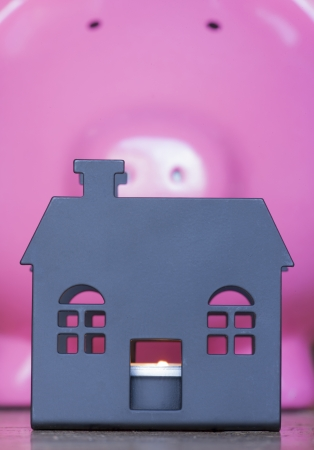repossessed: house silhouette with piggy bank