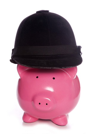 horse riding: Piggy bank wearing a horse riding hat cutout