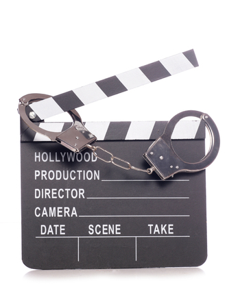 hollywood movie: film clapper with handcuffs studio cutout