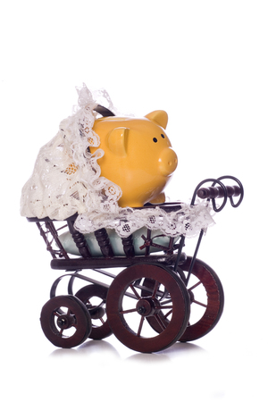 cost of child care piggy bank cutout photo