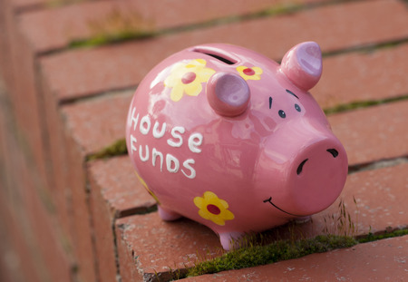 house funds piggy bank on a wall photo