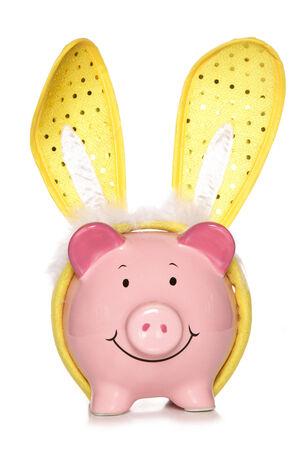 Piggy bank wearing easter bunny ears cutout photo