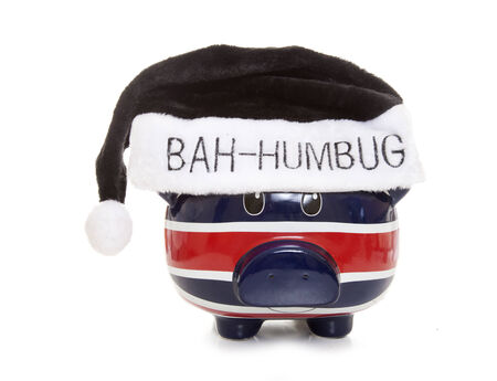 humbug: piggy bank wearing a scrouge bah humbug hat cutout Stock Photo