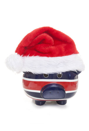 piggy bank wearing a father christmas hat cutout photo