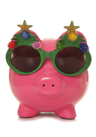 christmas savings: Piggy bank wearing christmas glasses cutout Stock Photo