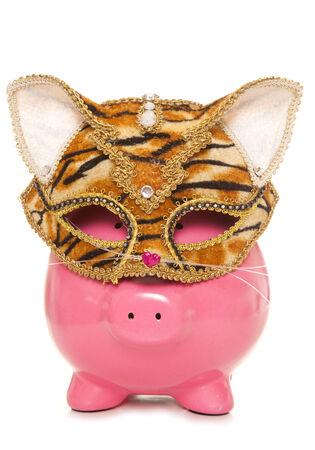 piggy bank wearing tiger masquerade mask cutout photo