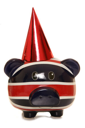 Piggy bank wearing red party hat cutout photo