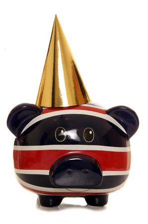 Piggy bank wearing gold party hat cutout photo