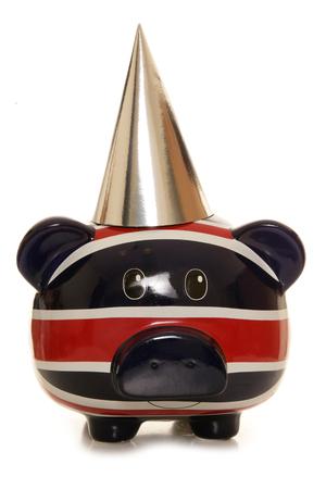 Piggy bank wearing silver party hat cutout photo