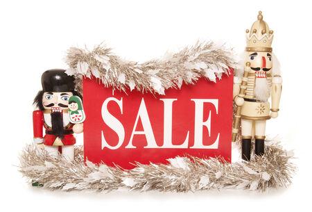 christmas sale sign with nutcracker ornaments cutout photo