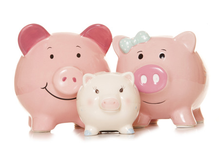 taxes budgeting: saving money as a family piggy banks cutout