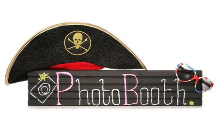 Photobooth sign with pirate hat and sunglasses cutout photo