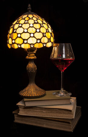 cosy: cosy evening read with red wine cutout Stock Photo