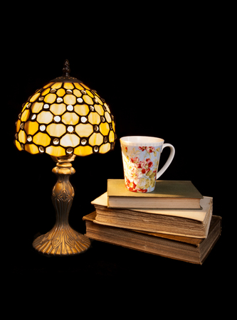 reading at night with a tea cutout photo