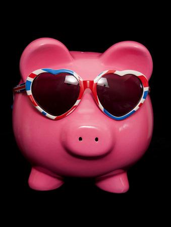 bargain hunting: piggy bank wearing union jack heart sunglasses cutout