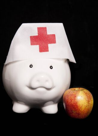 health care funding: apple a day keeps the doctor away cutout Stock Photo