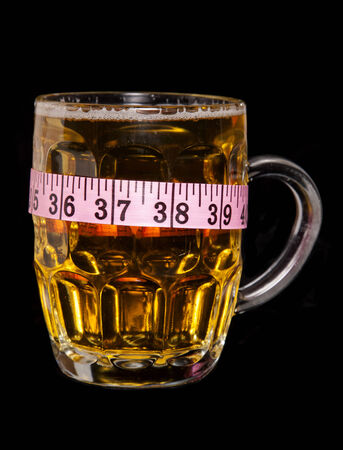 cutout: beer with tape measure cutout Stock Photo