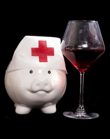 cutout: piggy bank nurse with red wine cutout Stock Photo