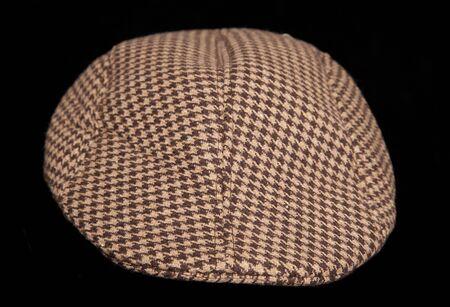 flat cap: farmers flat cap studio cutout Stock Photo