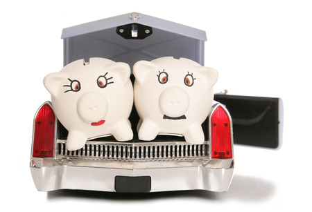 mr and mrs: mr and mrs piggy bank in back of american car cutout