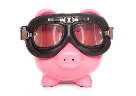 winter blues: piggy bank wearing googles cutout Stock Photo