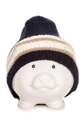 貯金箱 woolie 帽子素材を身に着けています。