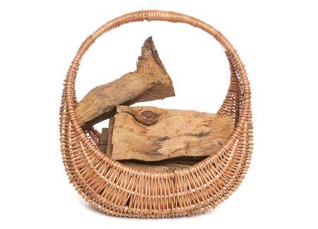 log basket: fire wood in a wicker basket cutout Stock Photo