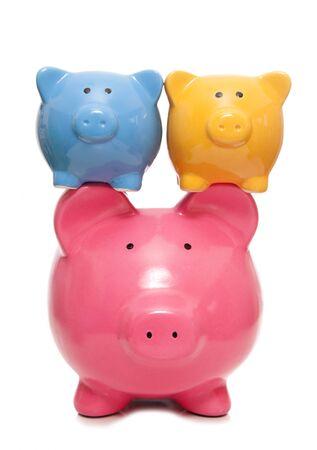 fostering: balancing your finances piggy banks cutut Stock Photo