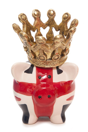 pig out: british piggy bank wearing a crown cutout